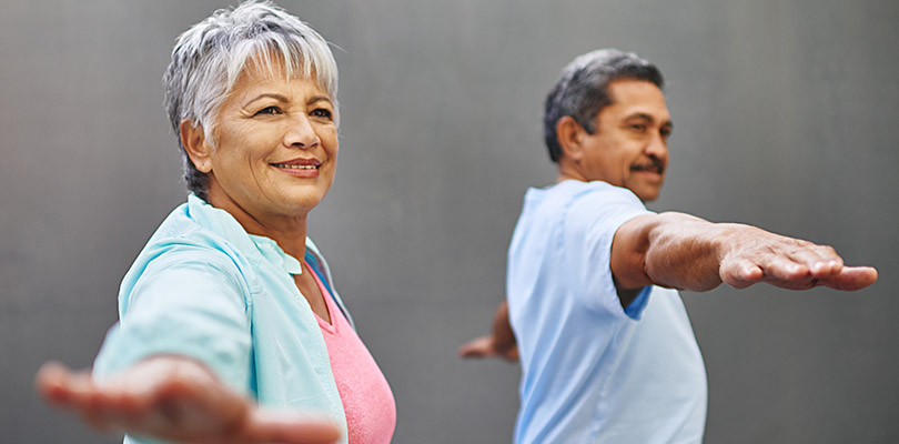 Two mature adults are exercising